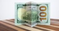 stock-photo-81253111-hundred-dollar-bill-with-folds-on-parque-table